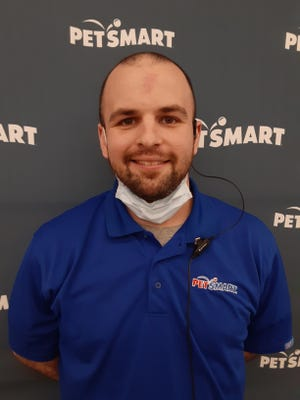 Eric Kent, PetSmart Customer Service Manager, made sure Saralee Perel and Bob Daly's trio of cats got fed. [BOB DALY]
