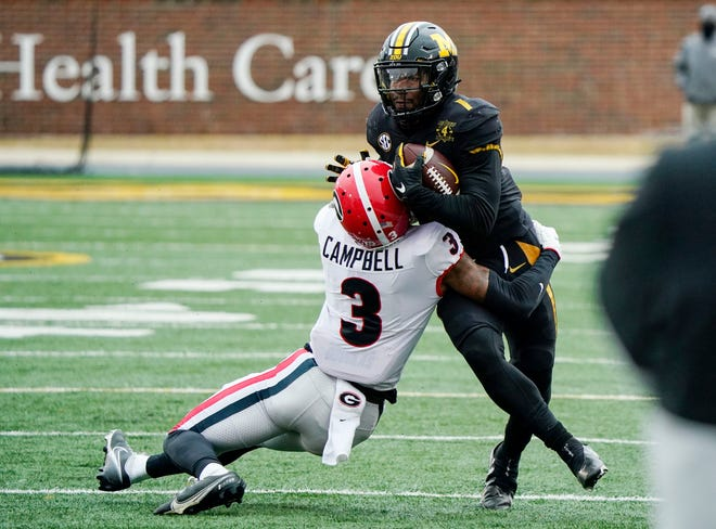 Missouri running back Tyler Badie (1) is tackled by Georgia defensive back Tyson Campbell (3) during a game Dec. 12 at Faurot Field.
