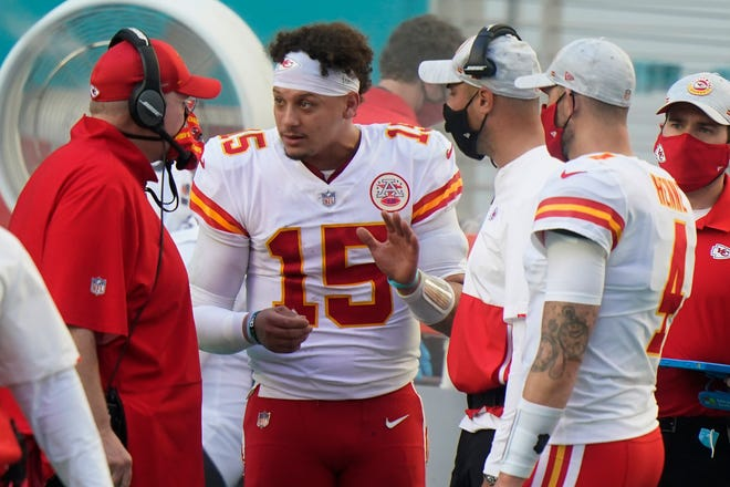 Kansas City Chiefs quarterback Patrick Mahomes (15) talks to head coach Andy Reid, left, on the sidelines during a game against the Miami Dolphins on Dec. 13 in Miami Gardens, Fla.