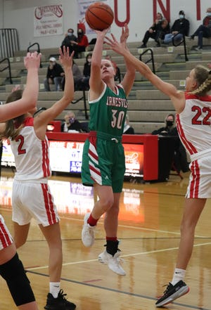 Barnesville senior Rylee Stephens (30) lets loose with a shot over a pair of Union Local defenders during Monday's game at Union Local High School.