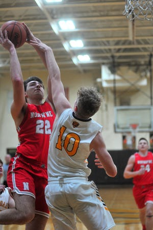 Trey Barkman tries to contest Norwayne's Joey Raudebaugh down low. Raudebaugh scored a game-high 18 points in the Bobcats' win.