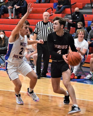 West Holmes senior Josh Shrock (2) works hard to defend Ashland scoring machine Luke Denbow during OCC action Tuesday in the Dungeon. Denbow still managed 14 points, including seven in the fourth quarter.