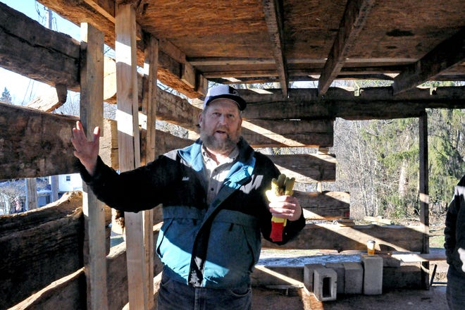 Matt Gress, who is in charge of rebuilding the log cabin, explains some of the problems they ran into.