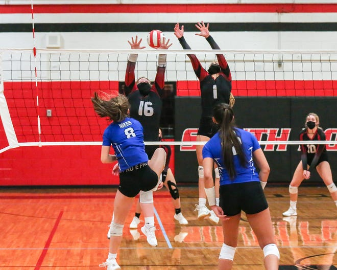 Emily Revels (16) and a South Point teammate go up for a block during a match against R-S Central in December. [BILL BOSTICK/Special to the Gazette]