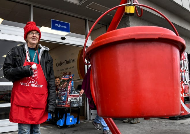 Julie Stieben works as a Salvation Army bell ringer in front of a Walmart entrance during a past Red Kettle campaign at one of the locations in Garden City. [BRAD NADING/GARDEN CITY TELEGRAM]