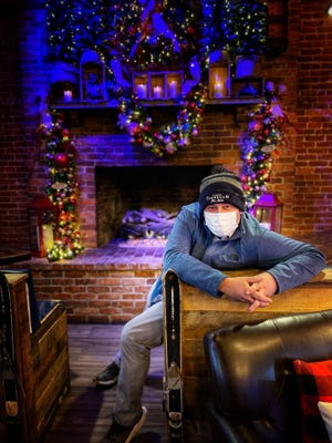 Tipsy Toboggan owner Karl Pelletier is seen in front of the cozy fireplact at the Fall River restaurant.