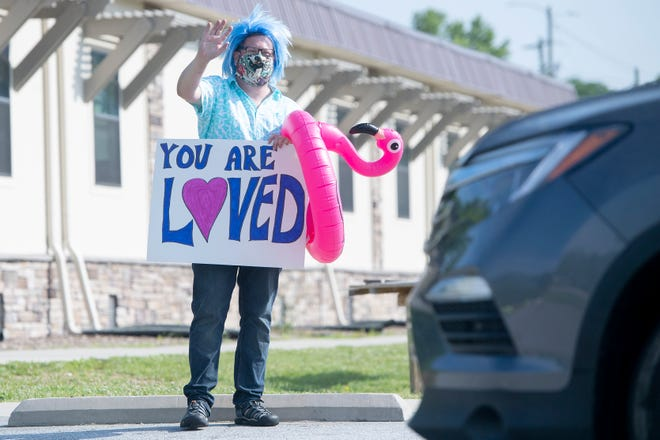 Students at FernLeaf Community Charter School in Fletcher paraded through the parking lot to say goodbye to their teachers for the summer on June 4, 2020. It was the teachers' first opportunity to see their students since March when the coronavirus pandemic closed in-person schooling.