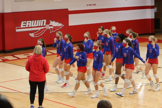 West Henderson's volleyball players walk to the sideline after a timeout during Tuesday's match at Erwin.