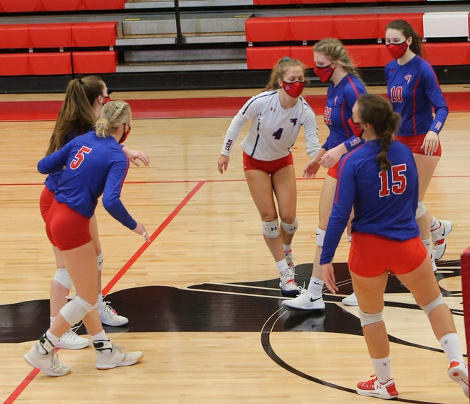 West Henderson's Julia Parent (4) is congratulated by her teammates after a match earlier this season at Erwin.