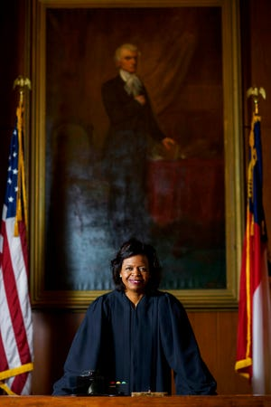 In this Feb. 13, 2019 photo, Judge Cheri Beasley poses for a picture from the Chief Justice's seat in a courtroom in Fayetteville. (Melissa Sue Gerrits/The Fayetteville Observer via AP, File)