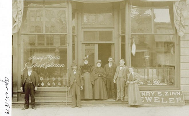 Henry Zinn and his employees in front of his shop at 9 N. Main in April of 1898