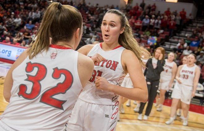 Morton's Katie Krupa shares a moment with teammate Makenna Baughman during player introductions before the start of their Class 3A state semifinal against Lanphier on Friday, March 6, 2020 at Redbird Arena in Normal. The Potters advanced to the state final with a 48-36 win over Lanphier.