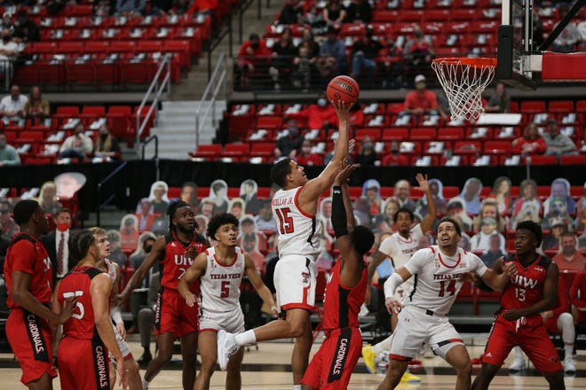 Texas Tech guard Kevin McCullar (15) drives against Incarnate Word guard Brandon Swaby (5) in the first half of a nonconference game Tuesday at United Supermarkets Arena. McCullar finished with 11 points, three rebounds and two assists in 12 minutes of play. [Michael C. Johnson/USA TODAY Sports]