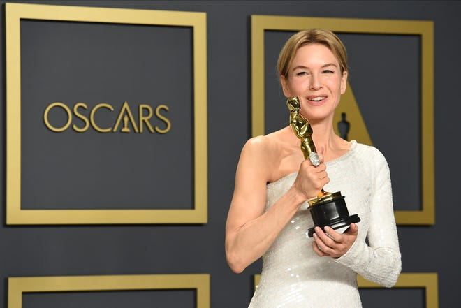 """Renee Zellweger, winner of the award for best performance by an actress in a leading role for """"Judy"""", poses in the press room at the Oscars on Feb. 9, 2020, in Los Angeles. Zellweger has earned her first Grammy nomination this year. The """"Judy"""" soundtrack, which features Zellweger covering songs like """"Over the Rainbow"""" and """"The Trolley Song,"""" is nominated for best traditional pop vocal album."""