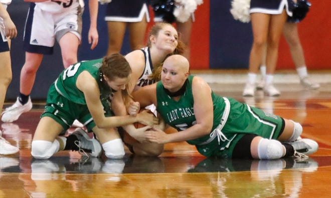 Ropes' Ava Falls (42) and Maggie Anderson (52) wrestle for the ball with Trinity Christian's Maddie Grace Ritchie (14) during the first half of a non-district game Dec. 29 2020 at the Lions Den in Lubbock.
