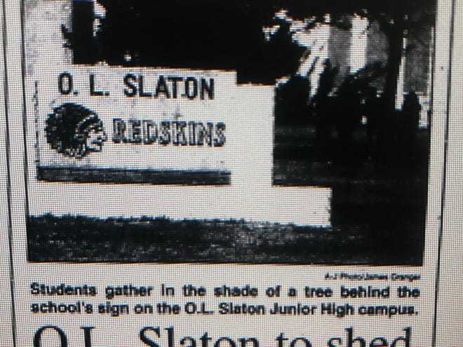 A newspaper clipping in 1999 showing the old sign outside O.L. Slaton.