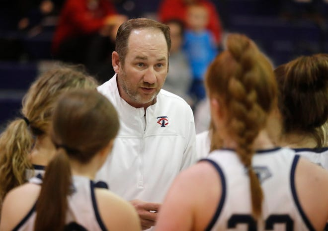 Trinity Christian head coach Josh Bailey talks to his players during a timeout in the first half of a nondistrict game Tuesday at the Lions' Den in Lubbock.