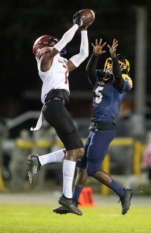 Lake Gibson  Cormani McClain (7) intercepts a pass against Winter Haven in November. McClain had an interception in every game he started at defensive back.