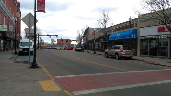 Milford police are seeking the driver of a black pickup that struck a 56-year-old woman in the crosswalk near the corner of Main and Fayette streets.