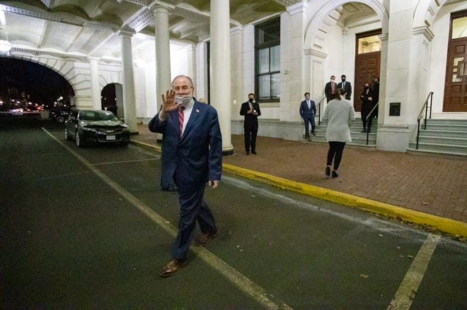 Speaker Robert DeLeo waved as he walked across the Mount Vernon Street archway to his car around 5:30 p.m. Tuesday, half an hour before his resignation took effect. [Sam Doran/SHNS]