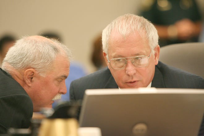 Chief Assistant State Attorney Ric Ridgway, right, confers with Assistant State Attorney Peter Magrino during a pre-trial hearing in the John Couey case at the Citrus County Courthouse in Inverness back in 2006. Ridgway is retiring after more than 30 years as chief assistant state attorney for the circuit that covers Marion, Lake, Sumter, Citrus and Hernando counties.