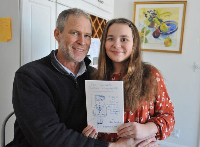 David Kornhaber, left, and his daughter, Ceili Kornhaber, 12, of Cohasset, pose with one of the self-published books made from David Kornhaber's ballpoint pen doodles that follow the life of a fictional character, Dr. Hempstead.