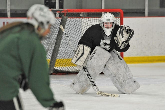 Canton goalie Carolyn Durand sets during girls hockey practice, Tuesday, March 10, 2020.