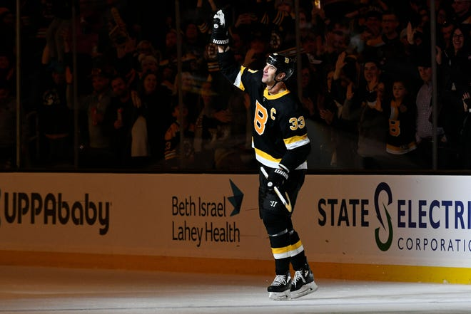 Boston Bruins defenseman Zdeno Chara (33) waves to the crowd after he is announced as the first star of the game against the Arizona Coyotes at the TD Garden on Feb. 8, 2020.