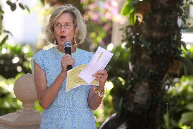 Mayor Gail Coniglio reads a proclamation during the Rededication of Earl E. T. Smith Preservation Park in 2019. Coniglio has announced she will not run for another term.