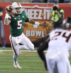 Miami Hurricanes quarterback N'Kosi Perry (5) looks to pass in the fourth quarter against Oklahoma State Cowboys during the 2020 Cheez-It Bowl at Camping World Stadium in Orlando on Tuesday, December 29, 2020.