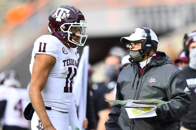 Texas A&M quarterback Kellen Mond (11) speaks to coach Jimbo Fisher during the final game of the regular season against Tennessee in Knoxville.