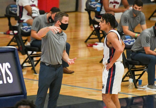FAU coach Dusty May  talks to guard B.J. Greenlee during a 128-64 victory against Florida National in Boca Raton on Dec. 3.