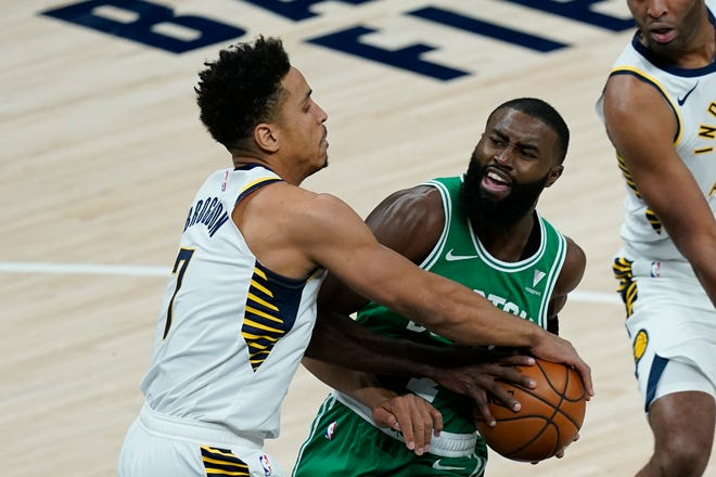 Boston's Jaylen Brown, right, is defended by Indiana's Malcolm Brogdon during the first half of Tuesday's game in Indianapolis.