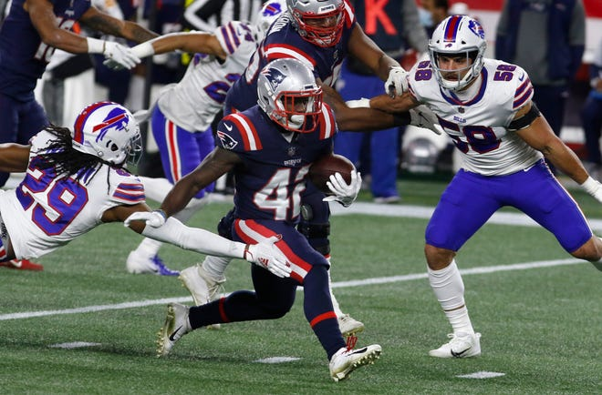 Foxboro, MA, Dec 28, 2020 - Running back J.J. Taylor gets a first down an more in the 2nd quarter for the Patriots.  His run set them up for their only touchdown of the game. The New England Patriots vs. the Buffalo Bills at Gillette Stadium on Monday evening.