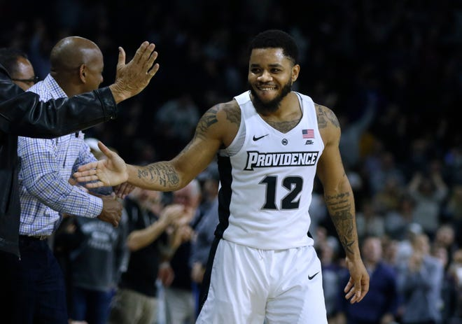 Providence College's Luwane Pipkins celebrates a win over Xavier with fans on March 4 at the Dunkin Donuts Center.  Just a few weeks later, the NCAA season ended.