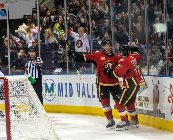 Corey Schueneman, left, and Austin Czarnik celebrate Czarnik's goal in the first period of a game Jan. 18 between the Stockton Heat and the Colorado Eagles. The Stockton Heat confirmed it will play its 2020-21 season in Canada, but still intends to negotiate to keep the team in the city beyond this season.