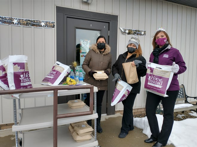 Senior citizens were recently welcomed to a holiday drive thru at the Streetsboro Senior Center. Similar events will be offered again in January. From left are Anisa Broska from the Gardens at Liberty Park, Streetsboro Senior Center Activities Coordinator Lynda Styles and Paula Baughman from Home Instead.