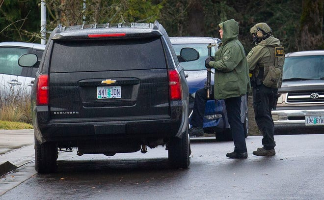 Springfield Police surround a home at the corner of S. 58th St. and S. 57 Place in Springfield Wednesday Dec. 30, 2020.