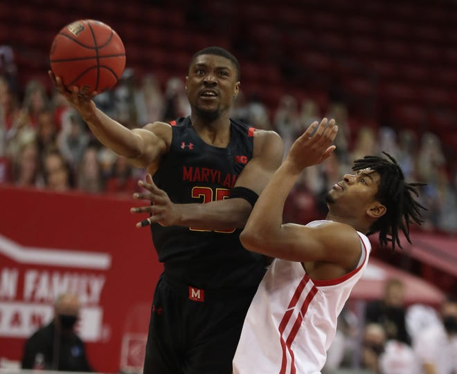 Maryland's Jairus Hamilton takes the ball to the basket against Wisconsin's Aleem Ford during a Dec. 28 game at the Kohl Center in Madison, Wis. Hamilton and the Terrapins host Indiana on Monday.