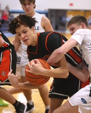 Hoover's Elijah Barker (left) fights for the ball with Louisville's Tyler Boldon during their game on Tuesday.