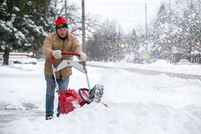 In this file photo, Jack Ream uses a snowblower to remove snow from his driveway on Harlem Boulevard on Dec. 30 in Rockford. Up to 6 inches of snow are expected Monday night and into Tuesday morning in the city.