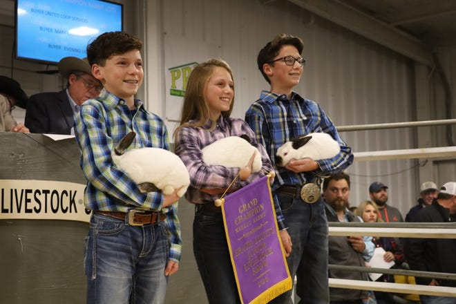 Exhibitors show off their prize-winning rabbits during the 2020 Erath County Junior Livestock Show. This year's show is scheduled for Jan. 5-9.