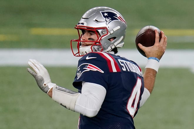 New England Patriots quarterback Jarrett Stidham drops back to pass in the second half of an NFL football game against the Buffalo Bills, Monday, in Foxborough, Mass.