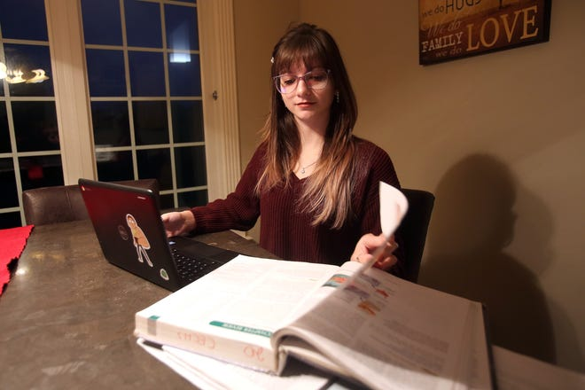 Bailey Payne, 17, studies at home in Boiling Springs. Payne recently received a full scholarship to Gardner-Webb University despite her struggles bouncing around the foster care system while growing up.