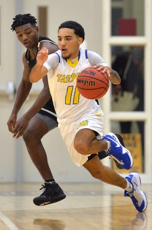 Charlotte High's Alex Gent #11 is pressured by Booker High's Sonny Jenkins during their semi-final game Tuesday night in the 29th annual Suncoast Holiday Classic on Tuesday night at Riverview High School.