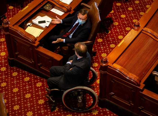 Illinois State Sen. Andy Manar, D-Bunker Hill, talks with Illinois State Sen. Dan McConchie, R-Hawthorn Woods, during debate on SB1863, a bill dealing with vote by mail and other changes for the 2020 election, on the floor of the Illinois Senate during session at the Illinois State Capitol, Friday, May 22, 2020, in Springfield, Ill. [Justin L. Fowler/The State Journal-Register]