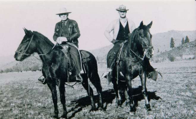 George Dillman is left and friend, Carver Gepford, is on the right posing at Oak Farm on Eastside Callahan Road in Scott Valley around 1934. Unknown photographer.