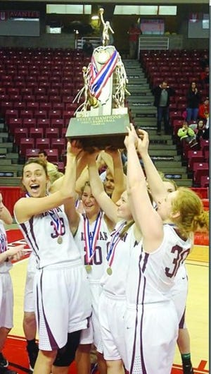 The Annawan girls basketball team hoists the 2017 Class 1A state championship trophy.