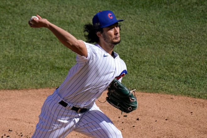 Chicago Cubs starting pitcher Yu Darvish throws during the first inning in Game 2 of the team's NL wild-card baseball series against the Miami Marlins in Chicago on Oct. 2. Darvish was traded to the San Diego Padres on Tuesday night.