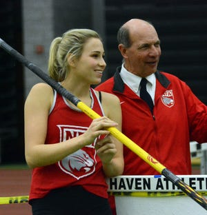 NFA's Paige Martin talks to coach Russ VerSteeg during the CIAC Class LL Indoor Track and Field Championships last February in New Haven.